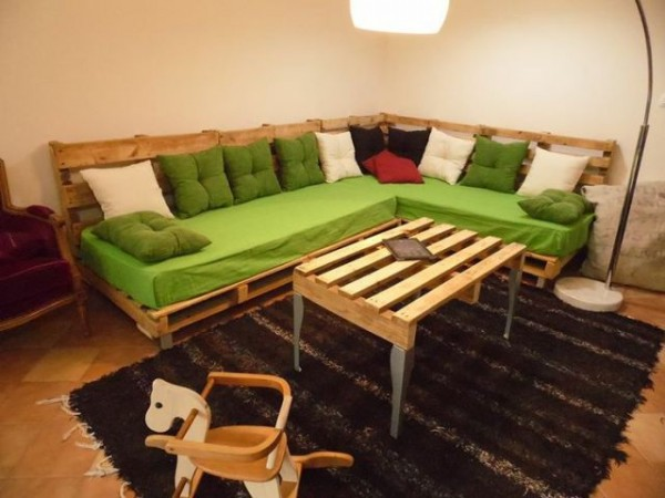 corner sofa with a table made with pallet